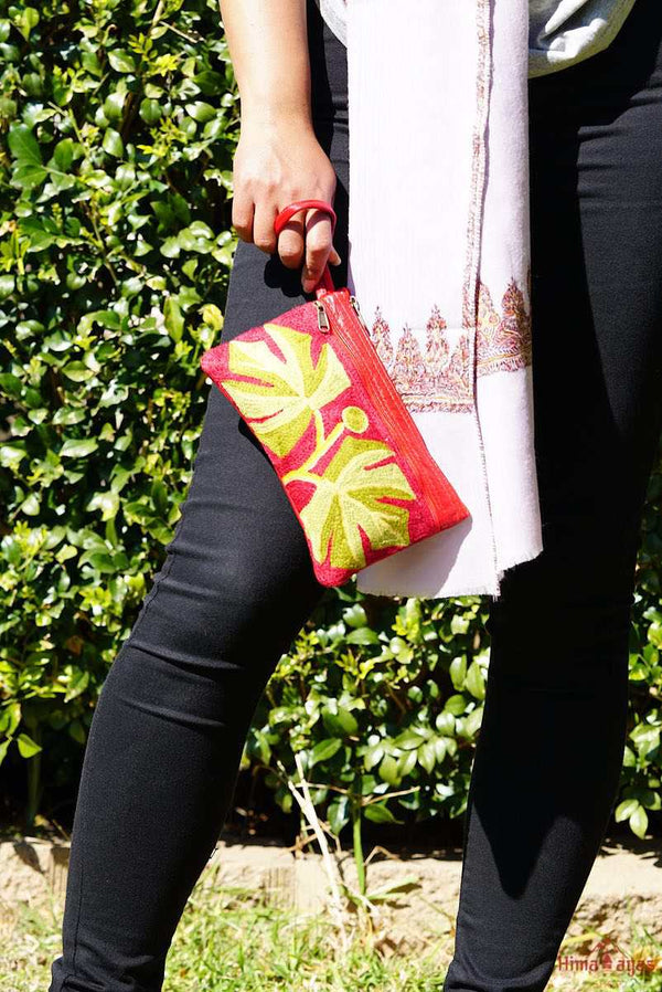 A beautifully hand-embroidered purse with a wristlet and a secure zip top closure. Perfect gift for your loved ones!