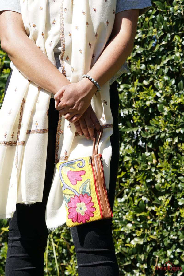 A stylish floral design women's purse, crafted with top quality hand-woven fabric, with PU leather at the back.