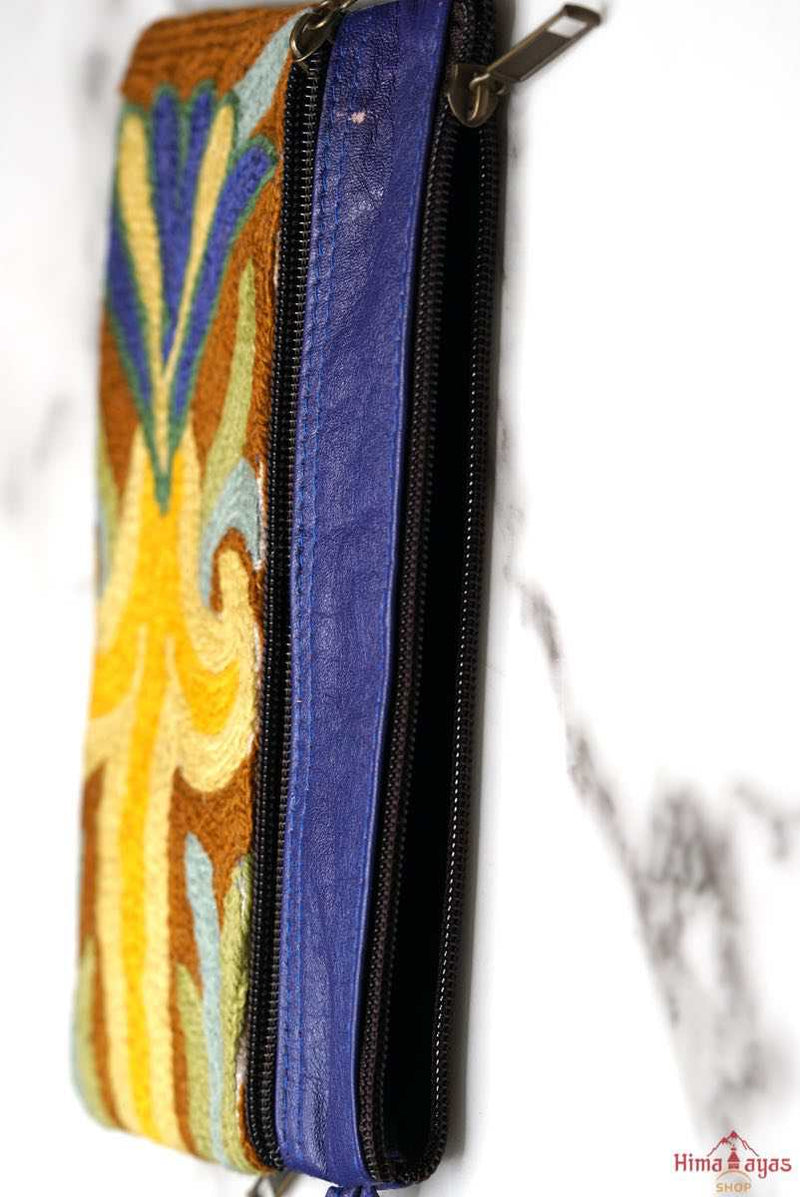 A stylish and ethically made wristlet purse to carry all your everyday essentials.