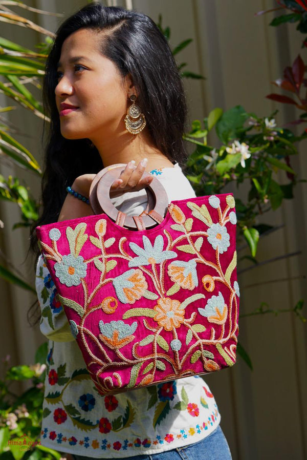 A classic women's tote bag, crafted with beautiful cashmere floral embroidery to give it a chic stylish look.