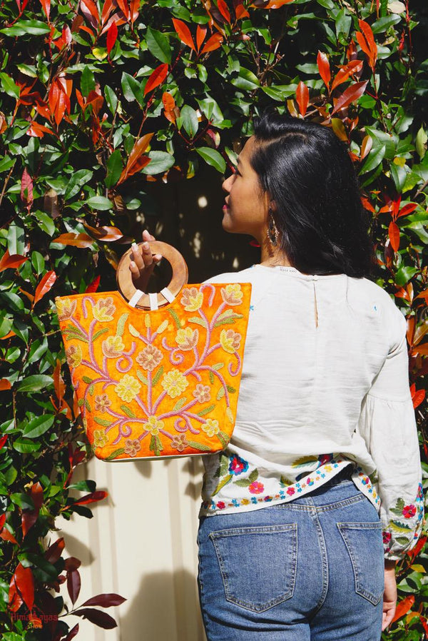A stylish women's tote bag with floral pattern, crafted ethically from Himalayas.