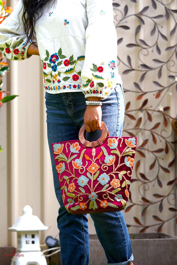 Beautiful hand embroidered tote bag with bright and multi-colour embroidered floral patterns.