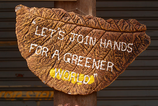 let's join hands for a greener world signage