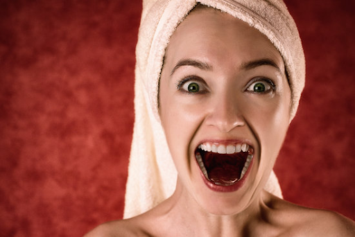 woman with towel on her head with mouth opened