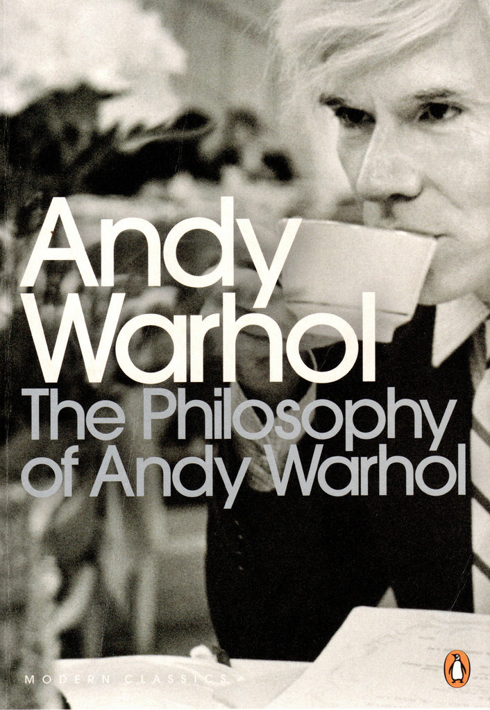 Book cover of The philosophy of Andy Warhol with photo of the artist drinking from a cup.
