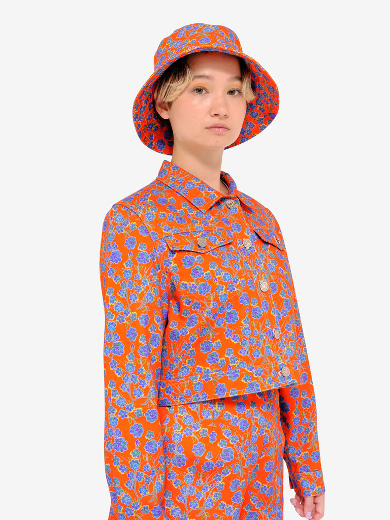 Crimson Rose 100% cotton drill cropped jacket with coordinating bucket hat and culottes in bright orange and blue floral print design.