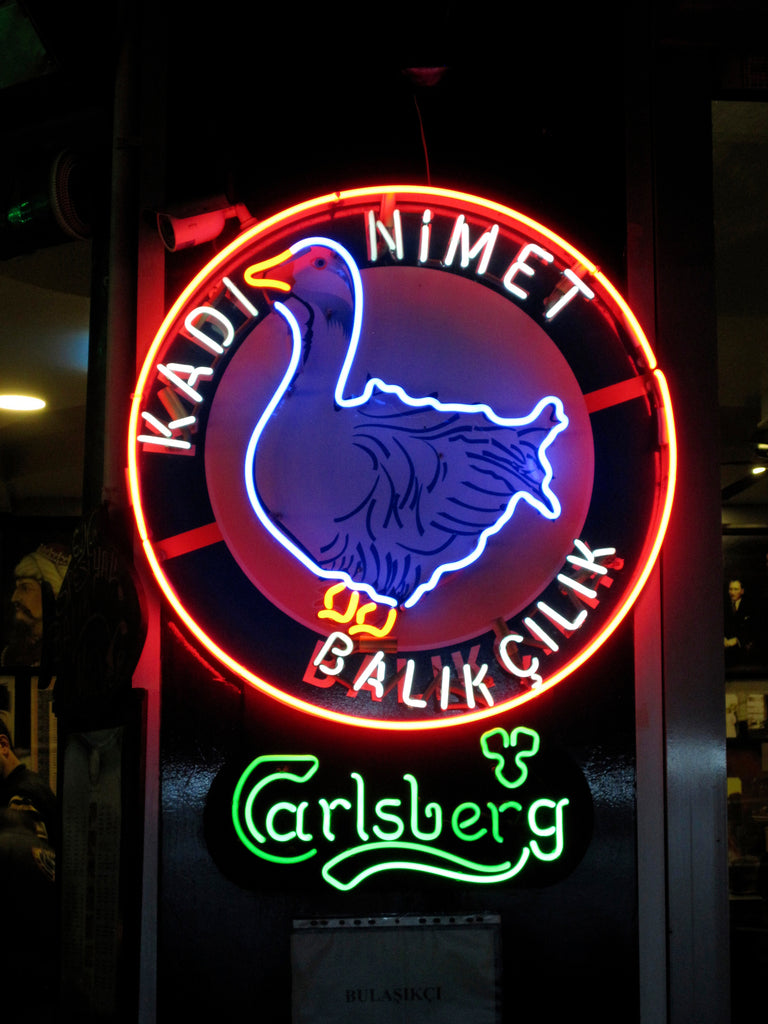 Photo of the neon sign with goose logo of the restaurant Kadi Nimet in Istanbul.