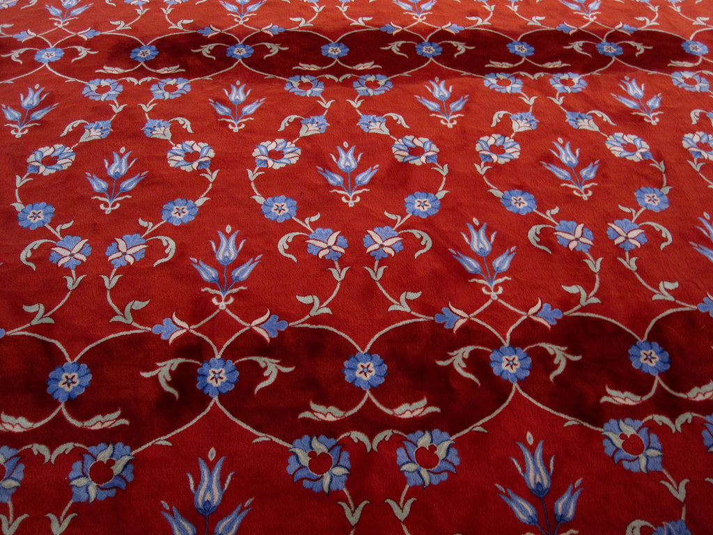 Photo of a red floral carpet in a mosque in Istanbul.