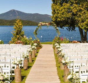 gold double hexagonal wedding arch at a lakefront venue