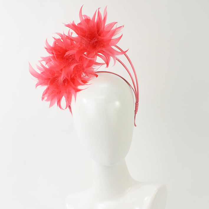 Jendi Feather Arches Fascinator in Coral on a Headband