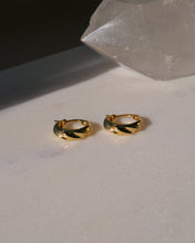 Load image into Gallery viewer, Small gold plated sterling silver hoop earrings with a wave croissant style texture