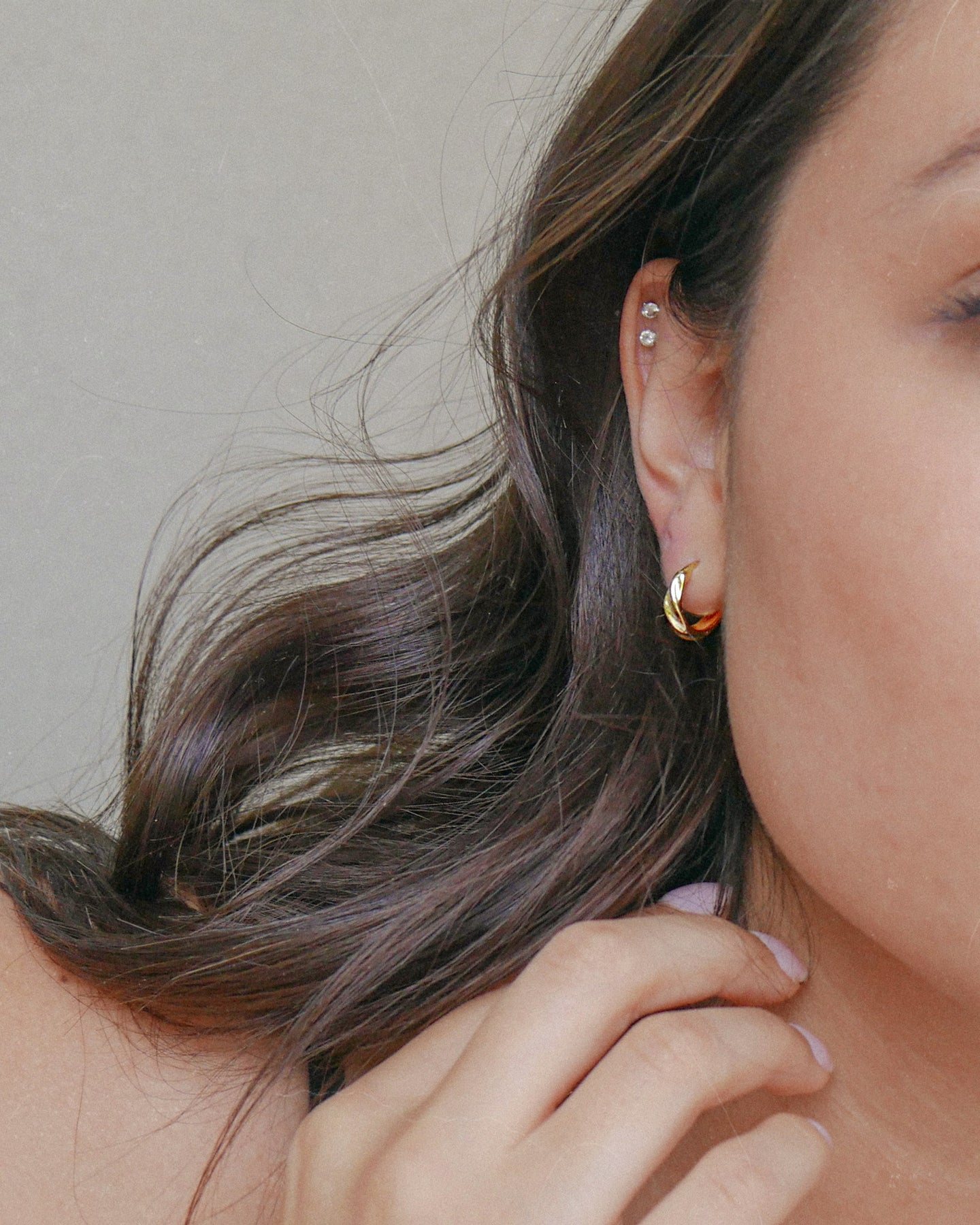 Small gold plated sterling silver hoop earrings with a wave croissant style texture