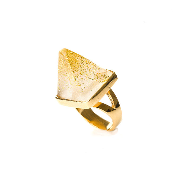 Clear pyramid ring with golden tip