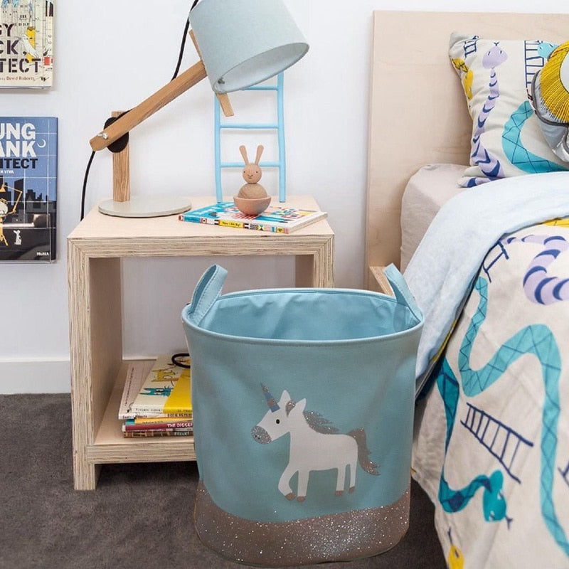 This beautiful blue cotton canvas unicorn basket is a great addition for amazing room decor