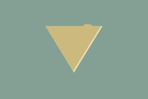 Scattered assortment of white and brown cone coffee filters