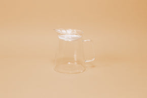 Clear all glass server with handle and clear plastic lid with perforations and white gasket