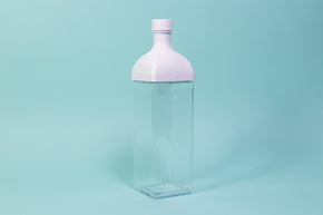 Clear plastic rectangular jug with white rectangular top and round cap.