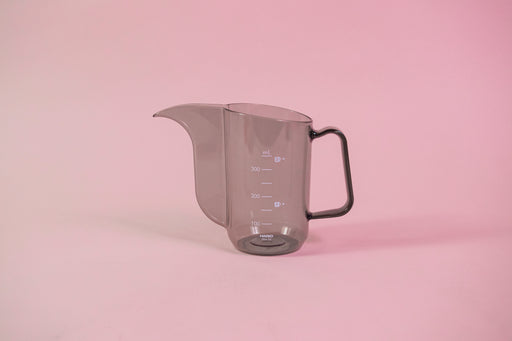 Transparent black plastic cup with handle and gooseneck style pour spout