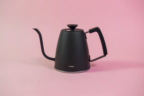 Matte black metal gooseneck kettle with black lid knob and rubber handle cover.