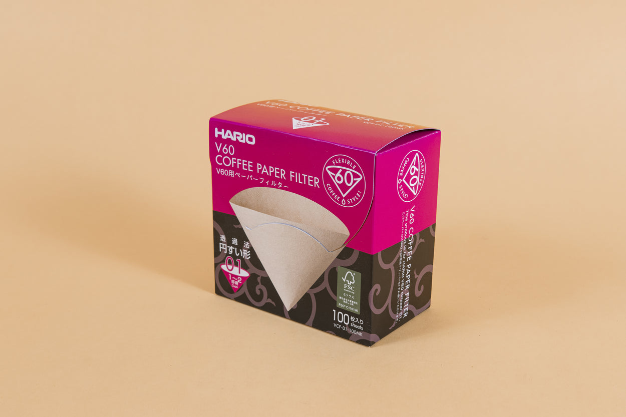 Large pink and black cardboard box with tabbed flip top lid with picture of brown filter cone on front with white text.