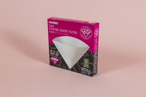 Pink and black cardboard box with picture of white filter cone on front with white text.
