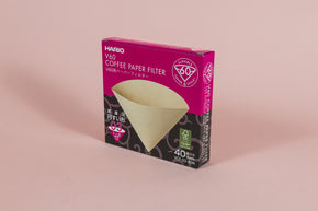 Pink and black cardboard box with picture of brown filter cone on front with white text.