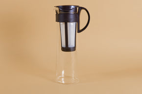 Tall glass server with white nylon mesh coffee filter insert and Chocolate Brown plastic handle and lid