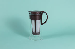 Short glass server with white nylon mesh coffee filter insert and Chocolate Brown plastic handle and lid.