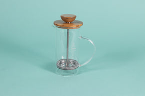 Skinny all glass press with handle, metal plunger and wood top and knob