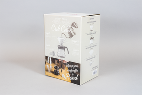 "Medium cardboard box. Depicting a Coffee pour over kit and ""craft coffee"" branding"