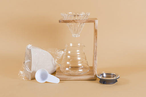 Wooden stand with clear glass conical dripper and all glass glass server, With a plastic pack of filters and scoop and glass lid