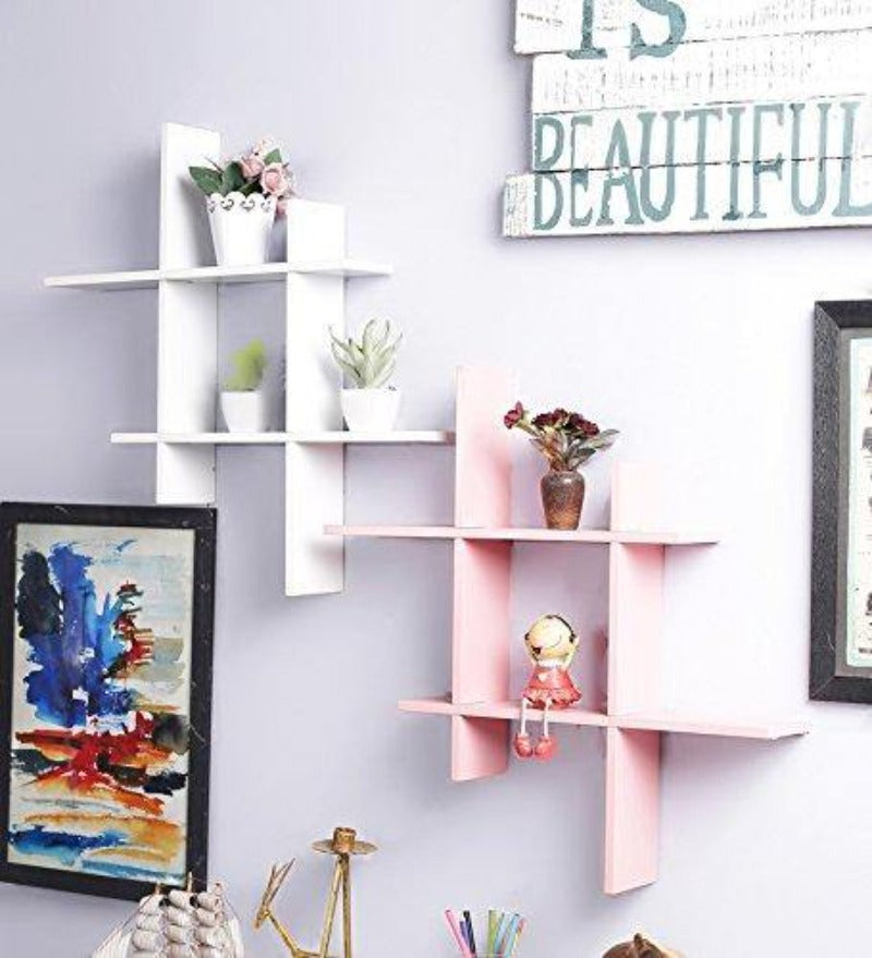 white and pink wall shelf