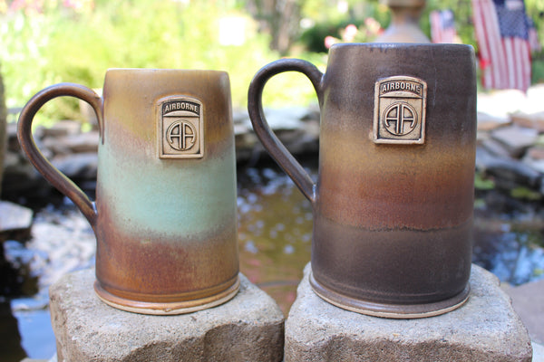 Photo of two 82nd Airborne Beer Mugs. The beer mugs are glazed (from left to right) in our Heirloom and Java schemes. Either one make fantastic military gift ideas. They also make wonderful gifts for veterans.