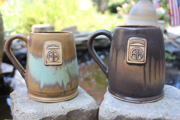 Two handmade 82nd Airborne Coffee Mugs, both made in American. The first coffee mug is glazed in our Heirloom Glaze Scheme. The second 82nd Airborne Coffee Mug is glazed in our Java scheme. Both make fantastic military gift ideas.