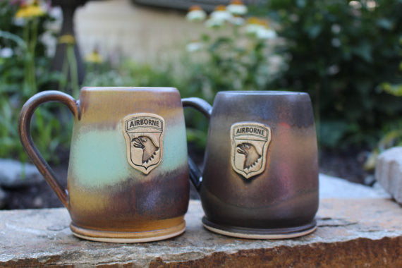 101st Airborne (Air Assault) Bullet Coffee Mug aka Screaming Eagles Coffee Mug. Handmade in America by Potter's Fire, LLC. Two mugs, one in Heirloom and the other in Java Glaze Schemes.