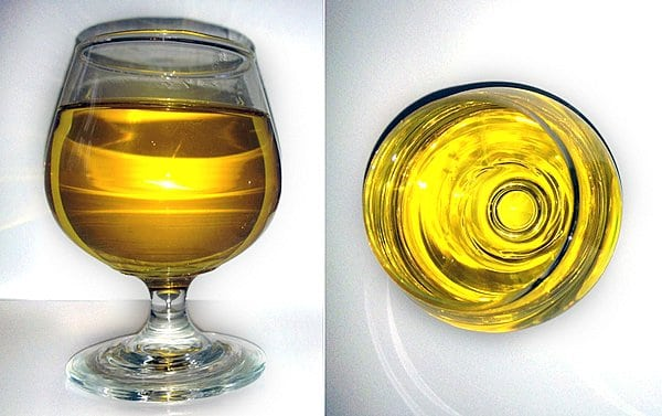 Golden EVCLO in wine glass