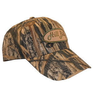 Mossy Oak Shadow Grass HillBilly Camo Trucker Hat with Tan Patch