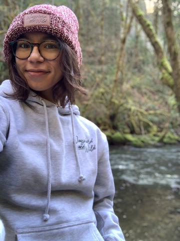 Wayward & Wild ambassador Esmeralda wearing our Chunky Knit Beanie with logo leather patch while out hiking in Oregon
