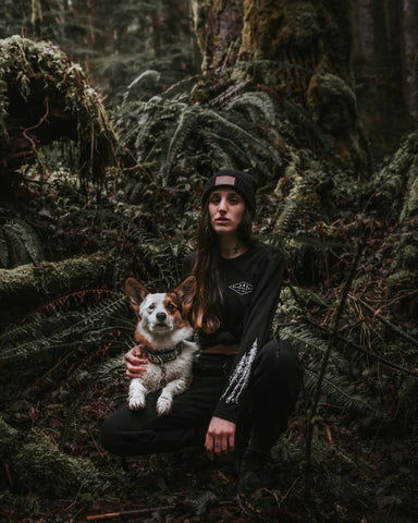 Wayward & Wild ambassador Wolfgang the corgi and his mom Kitty outdoors in Oregon's forests surrounded by ferns