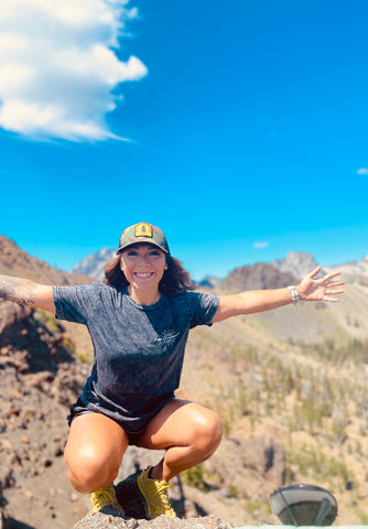 Wayward & Wild ambassador Shea wearing the Force To Be Reckoned With t-shirt while outdoors exploring