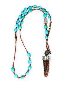 Sleeping Beauty turquoise necklace with petrified walrus tusk pendant with sterling silver and turquoise