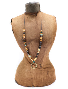 Olive wood, vintage African beads, horn, turquoise with a brass ring pendant