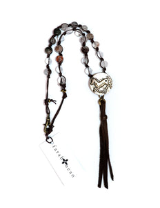 Designer button and lodalite necklace with suede tassel