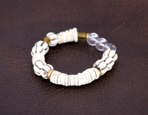 Carved cream beads with cream disc bracelet
