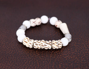 White jade, carved bone, African beads, silver, shed polished antler bracelet
