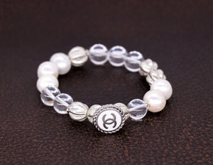 Freshwater pearls, carved silver and crystal quartz beads with a repurposed designer silver and white button bracelet