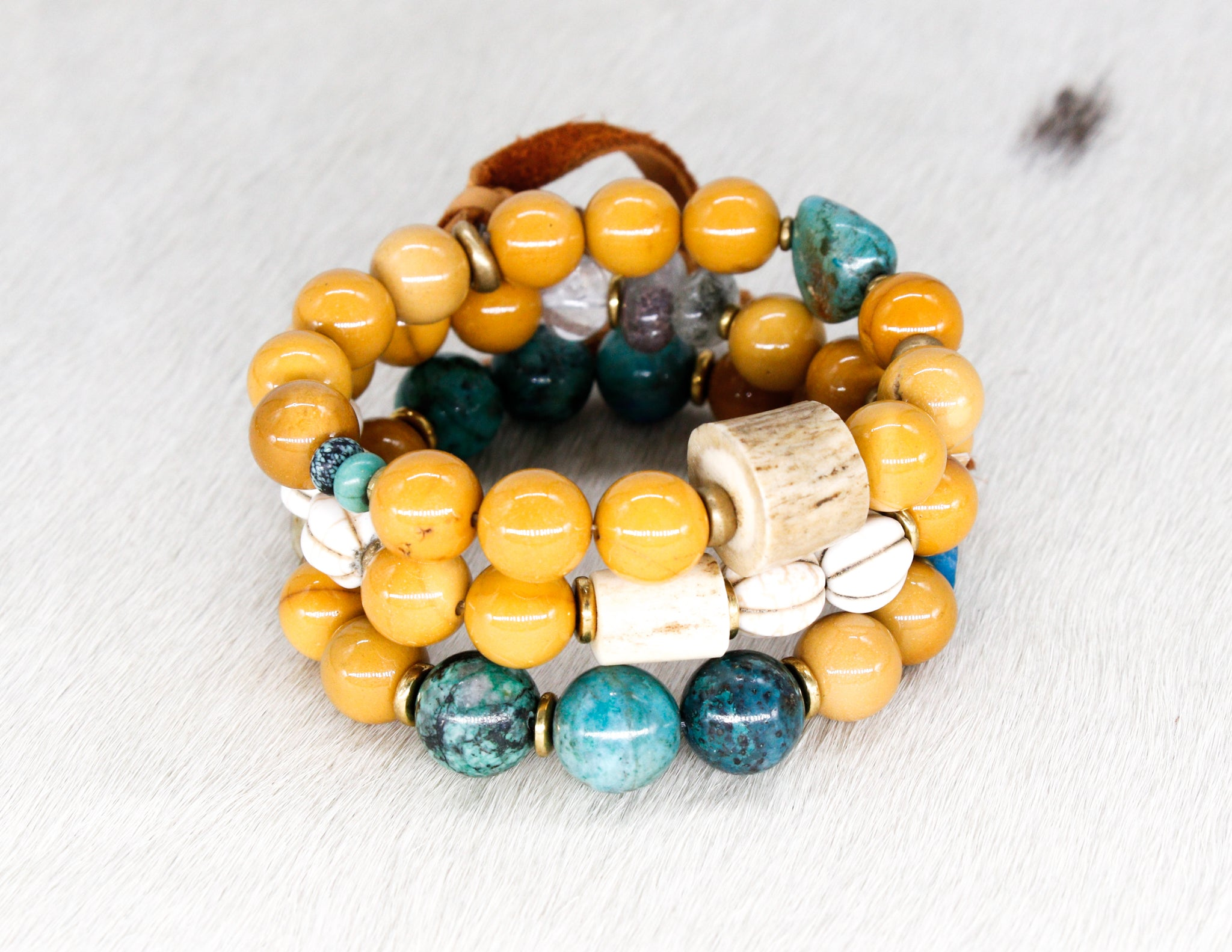 Mookaite with turquoise, shed antler, brass and suede tassel bracelet