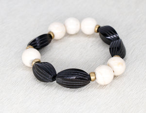 Black carved horn and cream bracelet