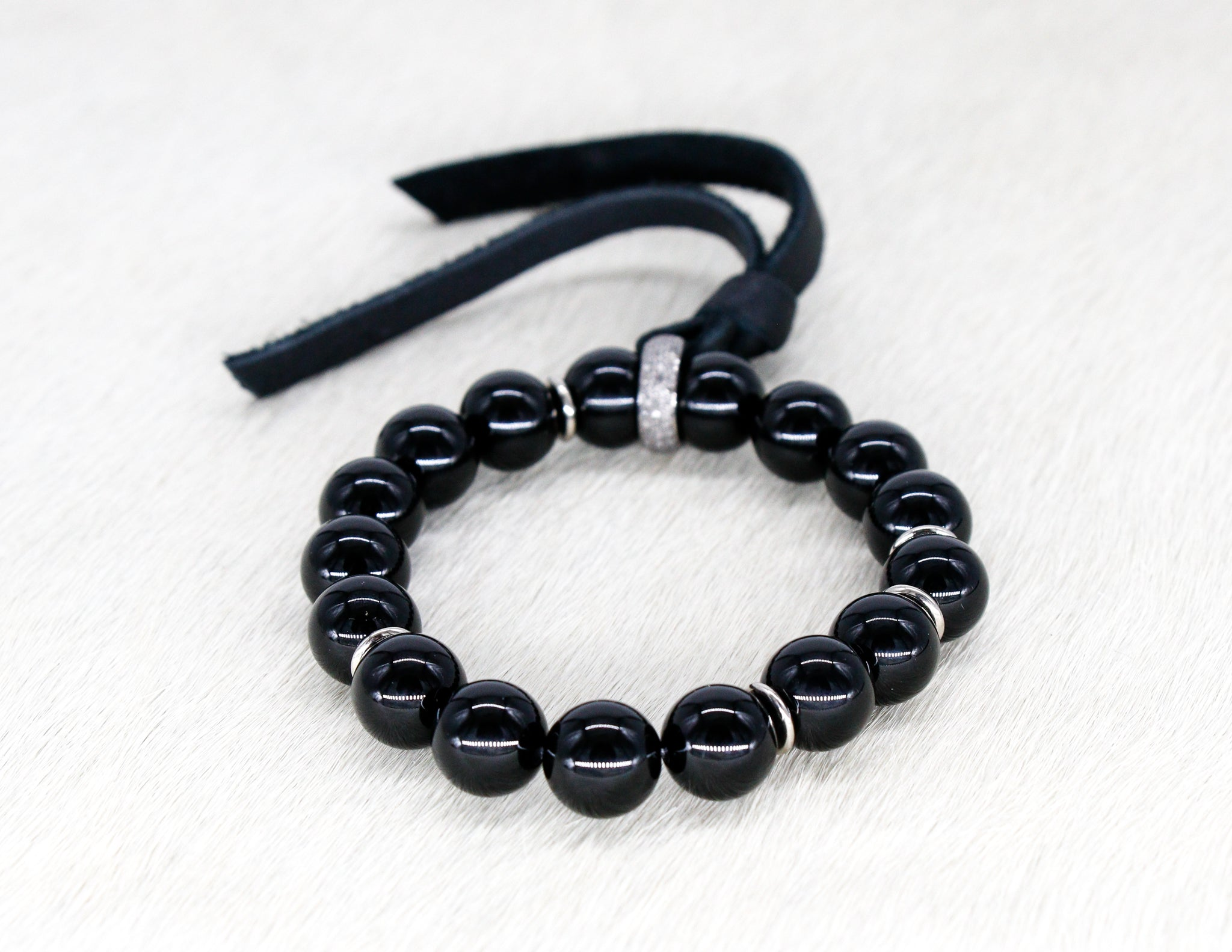 Black tourmaline bracelet with a pave diamond and suede