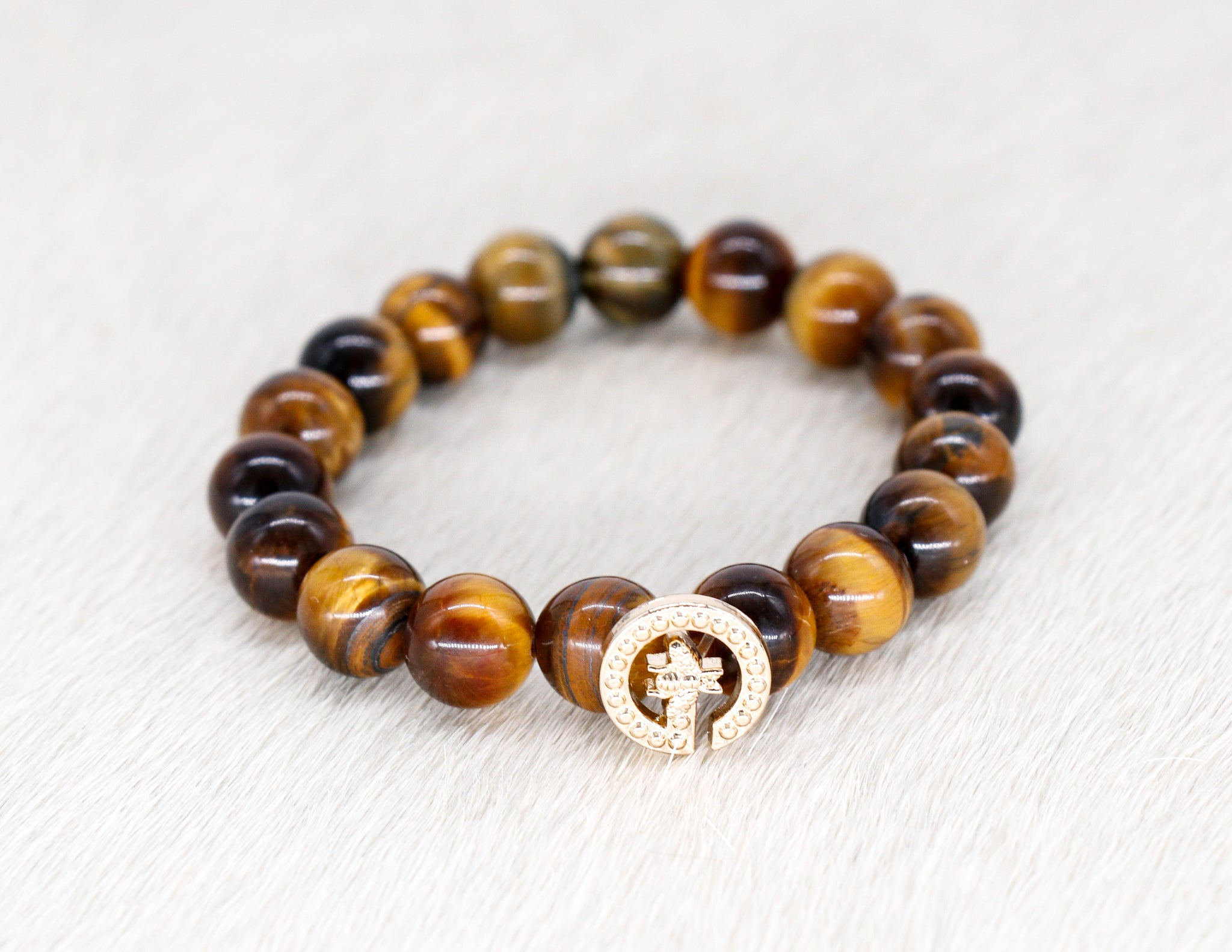 Tiger eye beads with a repurposed designer gold G with a bee button bracelet